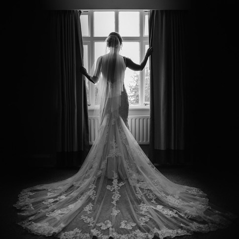 Bridal portrait in front of the window at Hollins Hall Hotel bridal suite near Leeds. Picture taken in the bridal suite