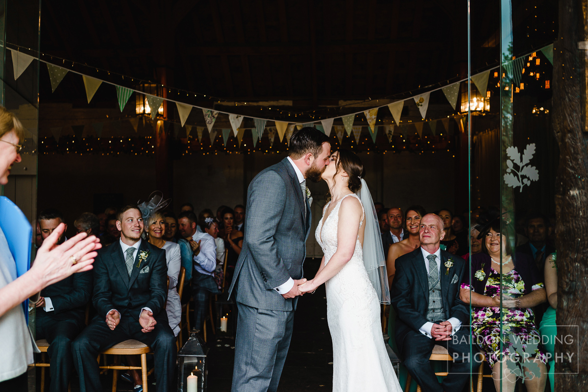 Bride and groom during their wedding ceremony at the rustic wedding venue East Riddlesden Hall