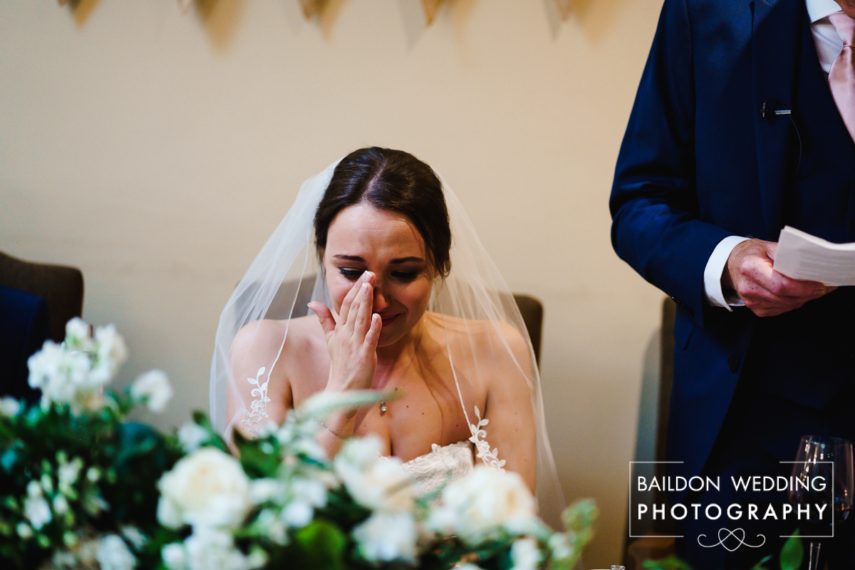 Tearful bride during emotional speeches