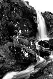 Black and white image of a small waterfall
