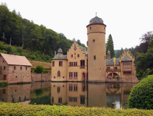 Schloss Mespelbrunn grounds with reflection of castle in pond