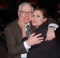 Robert shares a hug with the late Carrie Fisher (Leia Organa, Star Wars).