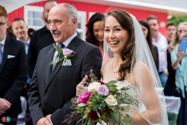 Smiling father of the bride walking his daughter down the isle