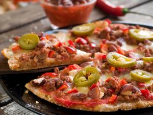 Mexican style pizza was created in Baja California, Mexico