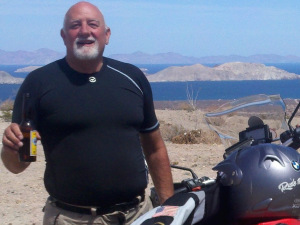 Ken with his motorbike. Image provided by Ken