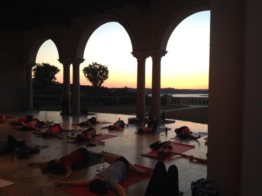 Baja Surf Yoga sunset class in supine twist overlooking Lake Travis