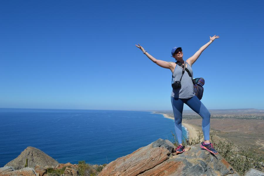 proud traveler on the mountain top