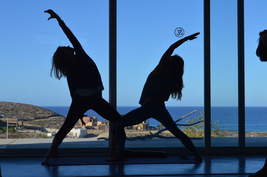 two yoga students silhouetted
