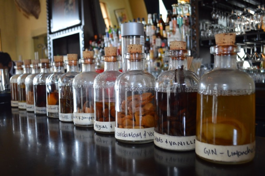 infusion jars sit on a bar