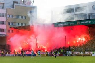 130623 Publiken tänder bengaler i matchen mellan Hammarby och Ängelholm i Superettan i fotboll 23 juni 2013 i Stockholm. ©Andreas L Eriksson