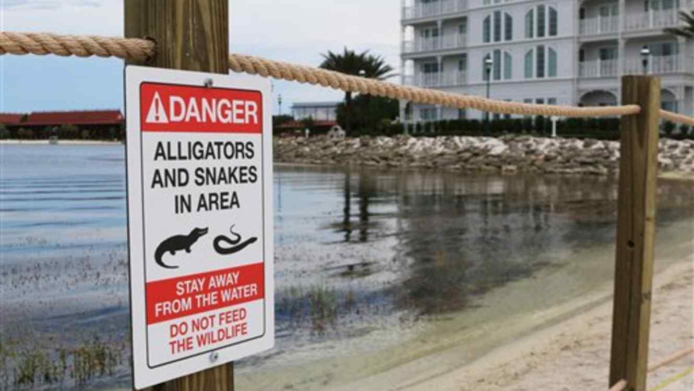 Señalar de peligro.