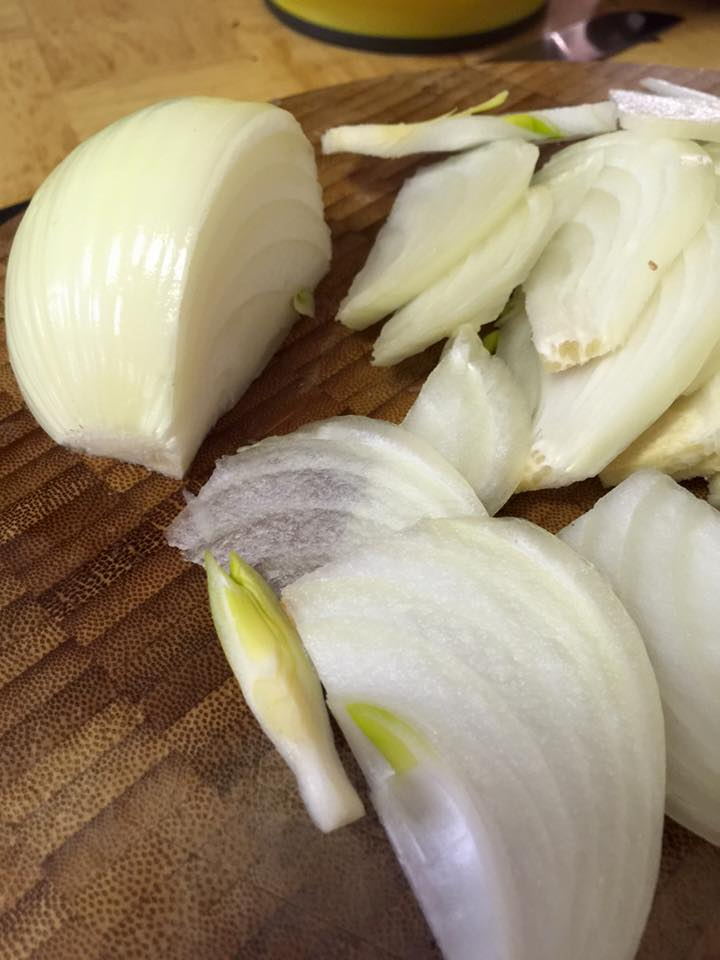 Onions are sliced parallel to the root end