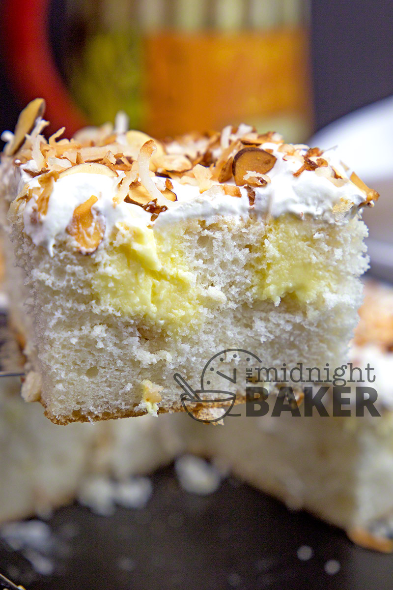 Toasted almonds and velvety coconut cream flavor this doctored-mix poke cake.