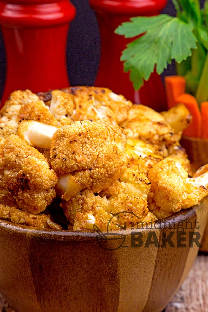 Roasted cauliflower flavored with buffalo sauce makes a great side dish or appetizer!
