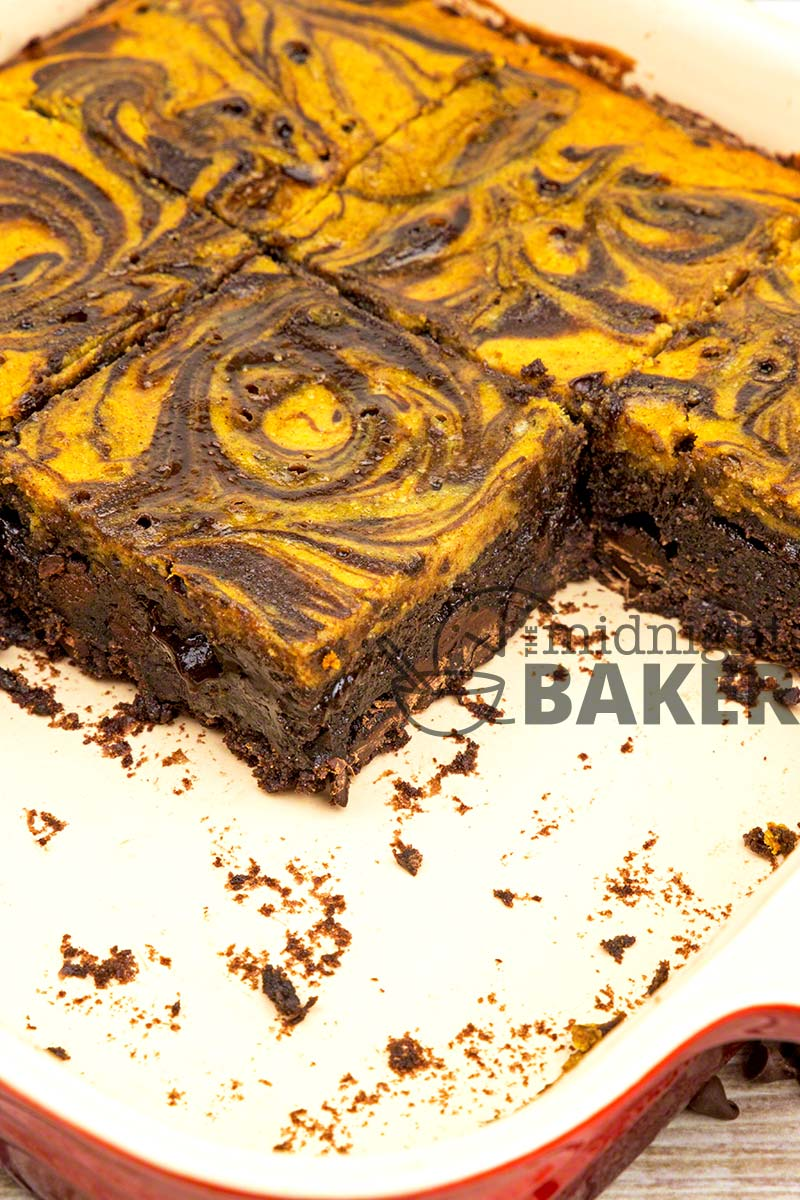 Kids and grownups alike will love these double chocolate brownies topped with a creamy pumpkin cheesecake.