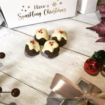 Christmas cakebites on a white background in front of a christmas cracker saying Have a Sparkling Christmas
