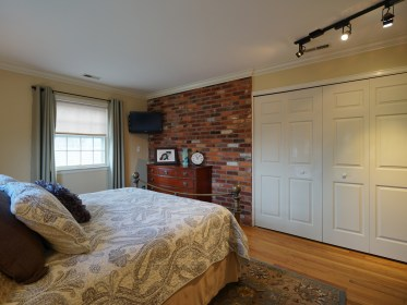 Master Bedroom with Brick Wall