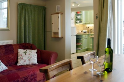 The dining room opens onto the kitchen