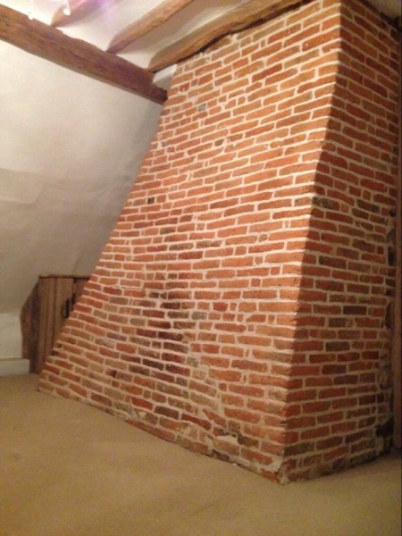 Stripped and cleaned brick chimney stack sealed with a micro-porous sealer