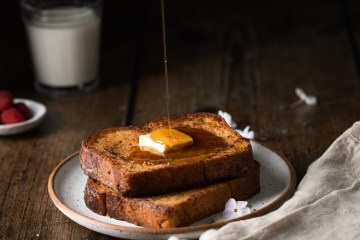 french toast with syrup being poured