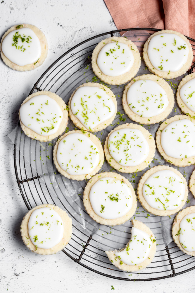 cooling rack with iced coconut lime cookies