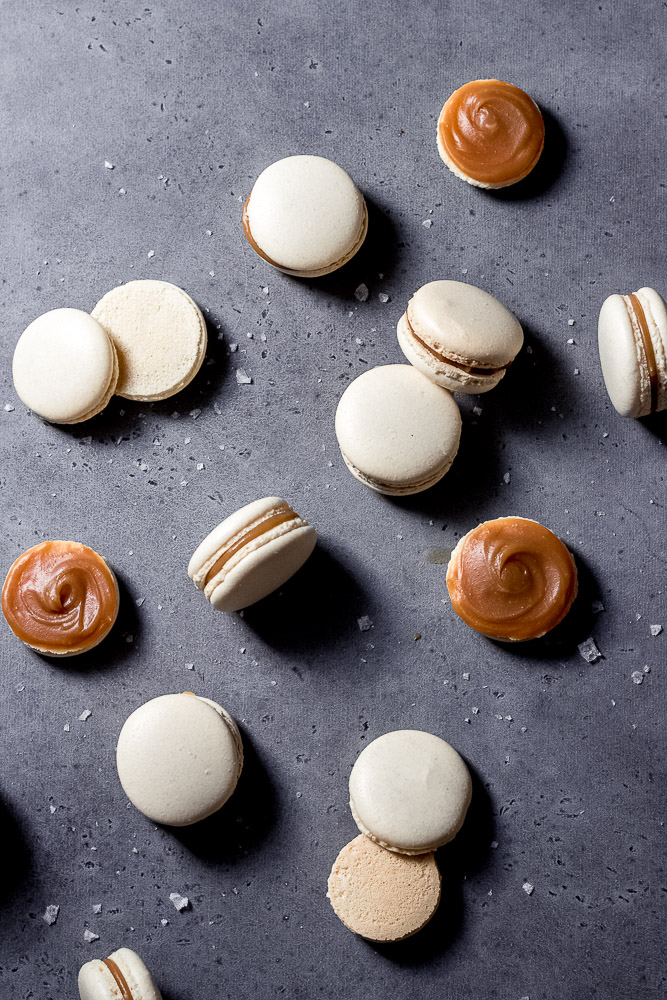 flat lay of salted caramel macarons with some open and some filled