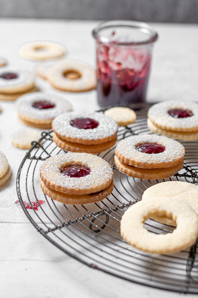 jam filled cookies on a wire rack