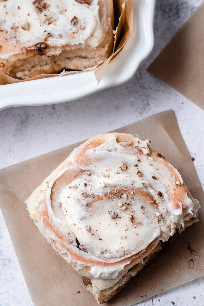 pecan cinnamon roll with cream cheese frosting