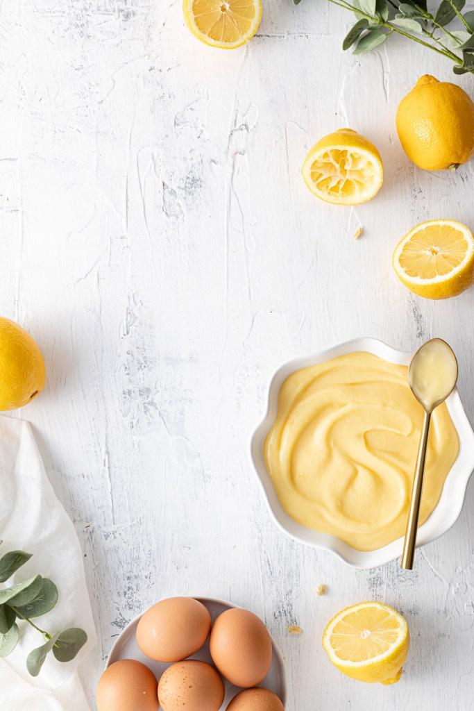 flat lay of lemon curd, lemons, and eggs
