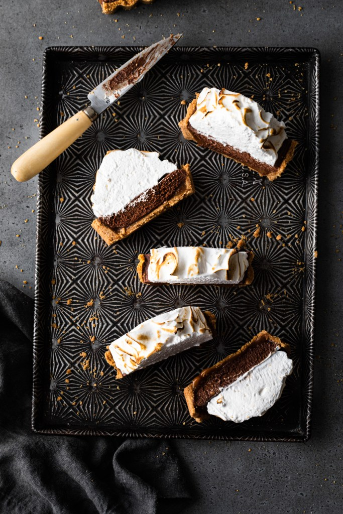 s'mores tart cut into slices on a baking pan