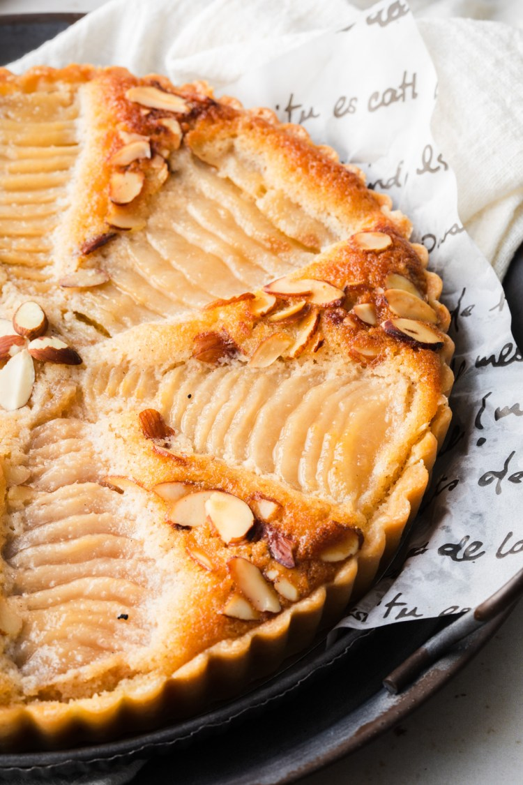 close up of pear frangipane tart showing sliced pears and almond cream