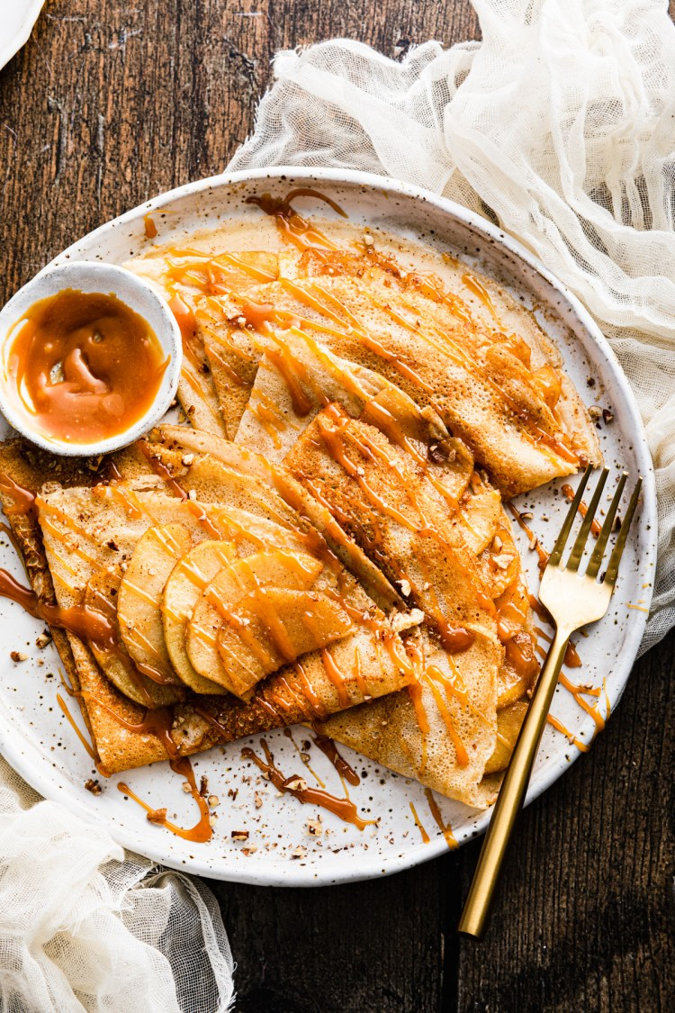 apple crepes with cinnamon, caramel, and pecans