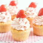 Light fluffy vanilla cupcake frosted with silky satiny strawberry swiss meringue buttercream.