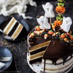 Pumpkin Chocolate Halloween Cake: the layers were moist and delicious and the frosting is like nothing else I've ever had! Really easy to decorate too, it's just candy but it looks incredible!