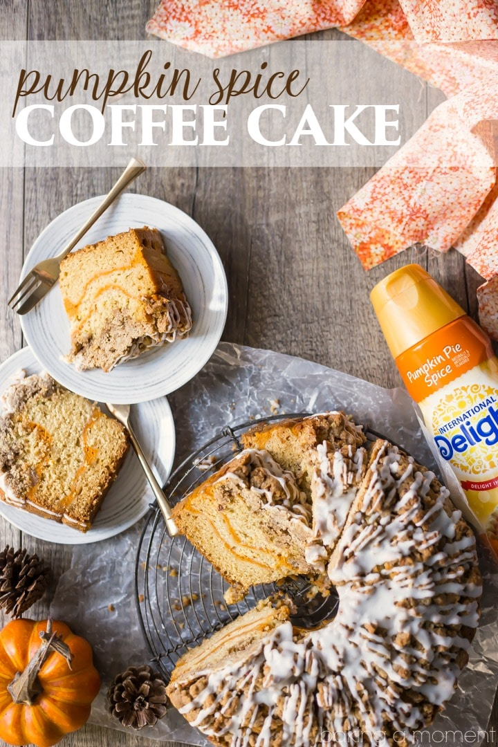 Pumpkin Spice Coffee Cake: moist sour cream coffee cake infused with pumpkin spice, ribboned with pumpkin and topped with a crunchy cinnamon crumb topping. Perfect for fall! food brunch cake#PumpkinDelight #IDelight @indelight #ad