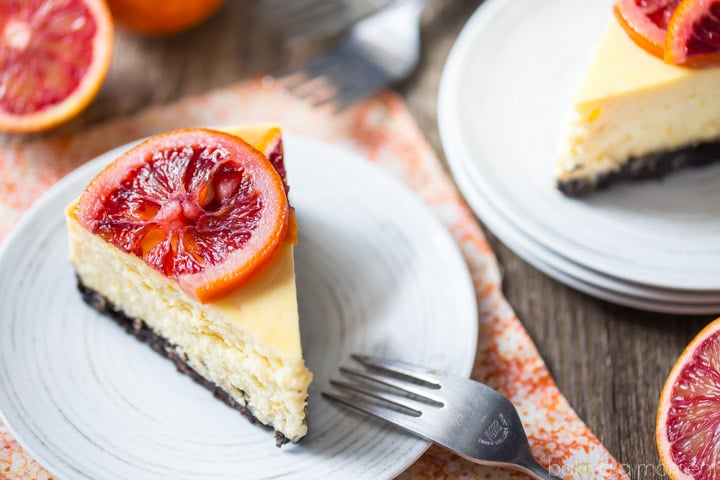 Blood Orange Cheesecake: the candied orange slices are so pretty and the citrus flavor works so well against the creamy cheesecake! The crunchy chocolate cookie crust is the perfect compliment. food desserts cheeesecake