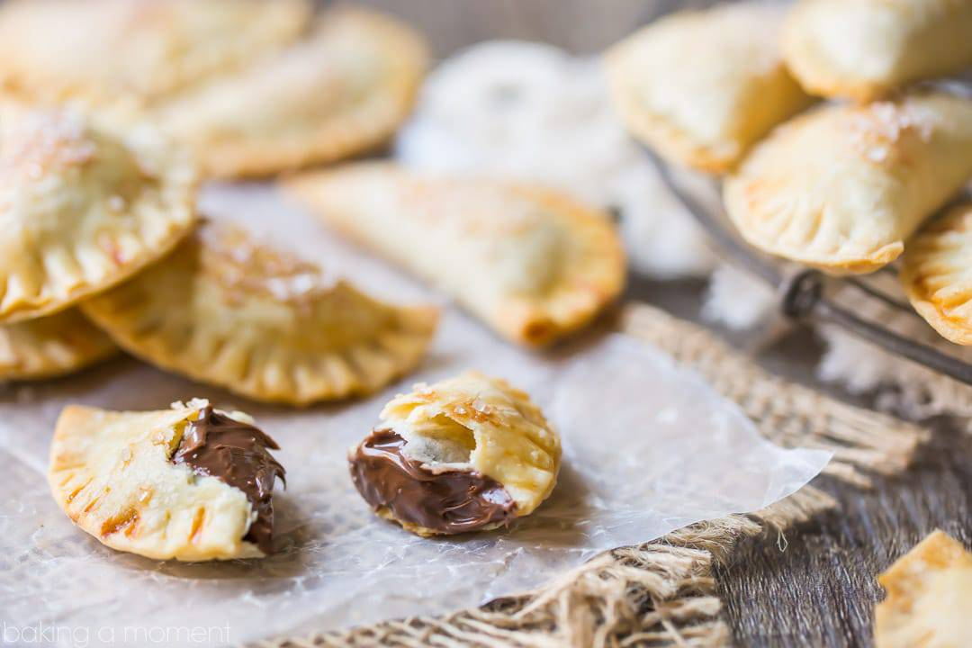 Baked Nutella Ravioli: buttery, flaky pastry surrounding a dollop of chocolate hazelnut spread.  YUM!  food desserts chocolate
