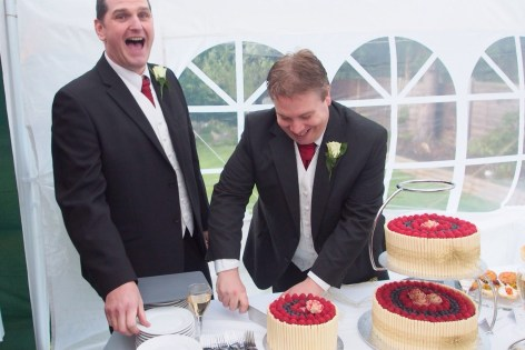 Simon (left) laughing at my inability to cut a cake!