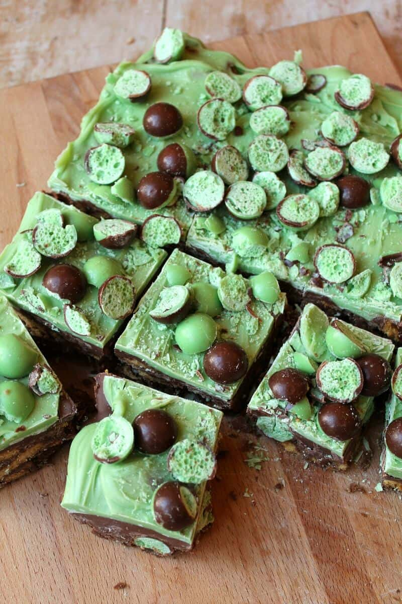 Mint Aero Chocolate Fridge Cake, a slab half sliced into squares on a wooden board, shot from above