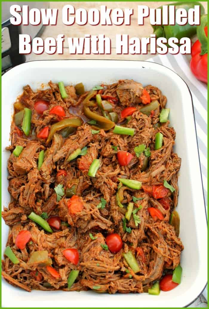 Slow Cooker Pulled Beef with Harissa - a delicious way to cook brisket of beef in your slow cooker to make tender shredded or pulled beef with a delicious harissa and tomato sauce, with tomatoes and green peppers. Ideal for a family meal any time of the year.