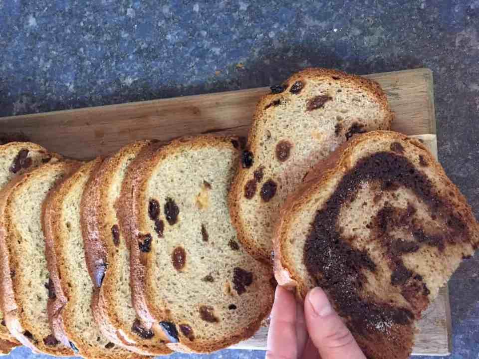 Vegan Cinnamon Raisin Bread on a wood cutting board