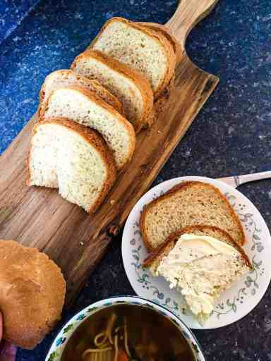 Vegan white bread sliced on a wooden cutting board