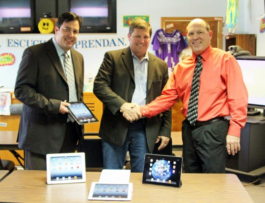 Sam Tallis, Shale president (left) and Sid Greehey, CEO (center) present donated iPads to Dave Selvig, superintendent of Scobey Schools (right).