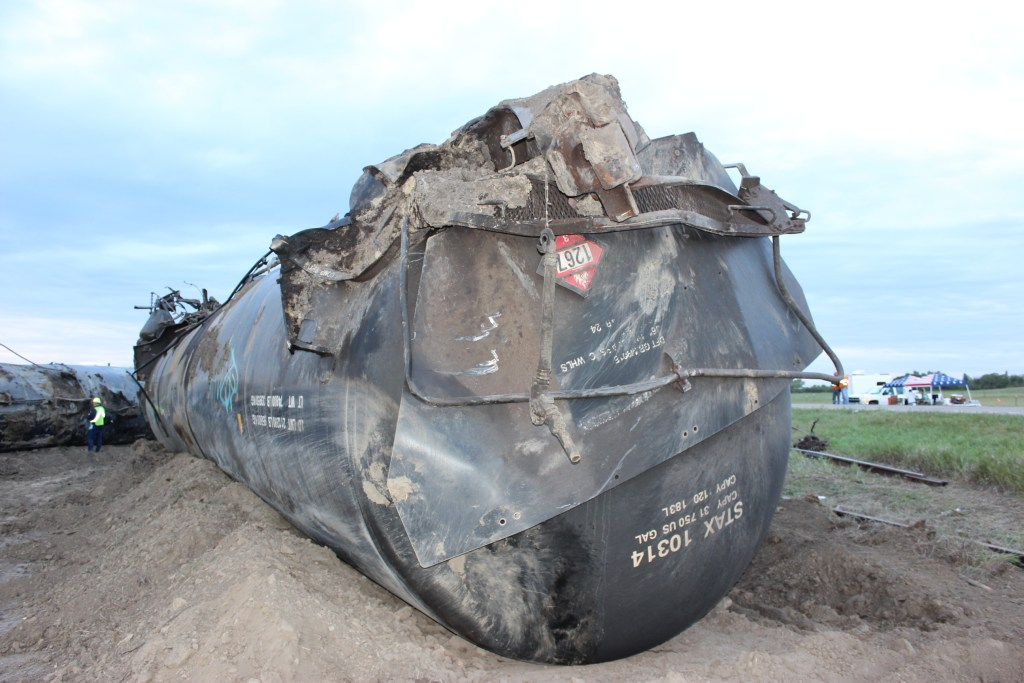 A DOT inspector in the background at the recent tank car derailment in Culbertson, MT. Image courtesy of the DOT.