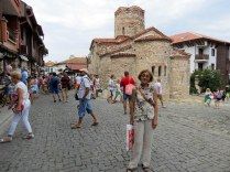 Mom in front of St. John the Baptist church, 10th century. You can see the traditional wooden houses on the left (second floor)