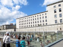Looking towards the wall leading up the Checkpoint Charlie with the Finance Ministry behind it.