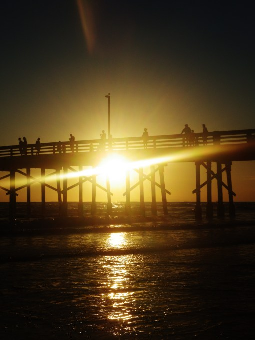 newport beach pier dark sunset