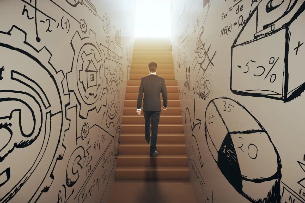 Back view of young businessman in suit climbing abstract narrow ladder with business sketches leading to bright light. Success concept. This picture represents the laws of personal development.