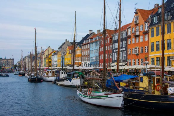 An image shows colorful buildings and boats on the banks of Copenhagen, Denmark, the country that was ranked by as the happiest in the 2016 World Happiness Report.