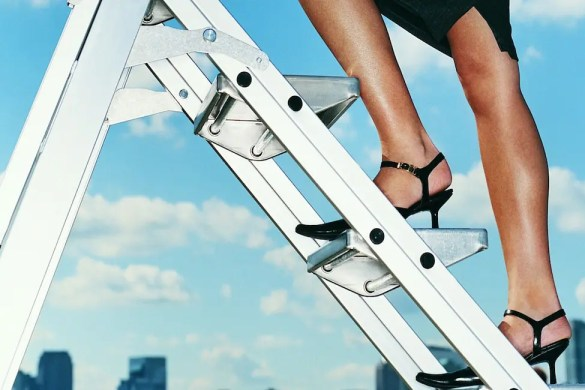 Career Advancement: A business women climbs a ladder. Only her legs are shown. This article discusses 2 Must-Dos as you climb the corporate ladder.